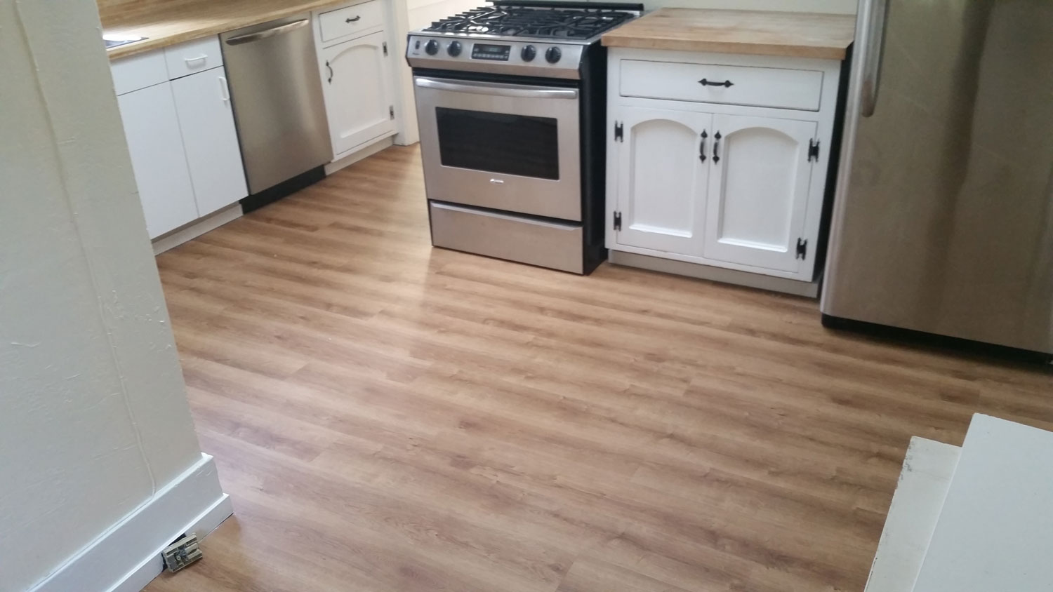 Water-proof LVT (luxury vinyl tile) installed over<br/>  dated linoleum floors to: living room, kitchen, laundry<br/> room, dining room. 1835 square feet total — Palo Alto.