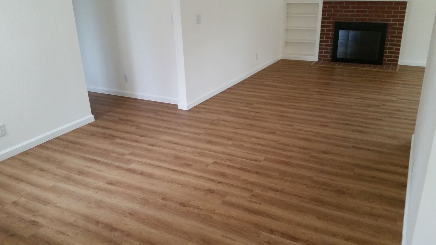 Water-proof LVT (luxury vinyl tile) installed <br/> over severely damaged hardwood flooring.<br/>  700 square feet total — Mountain View.