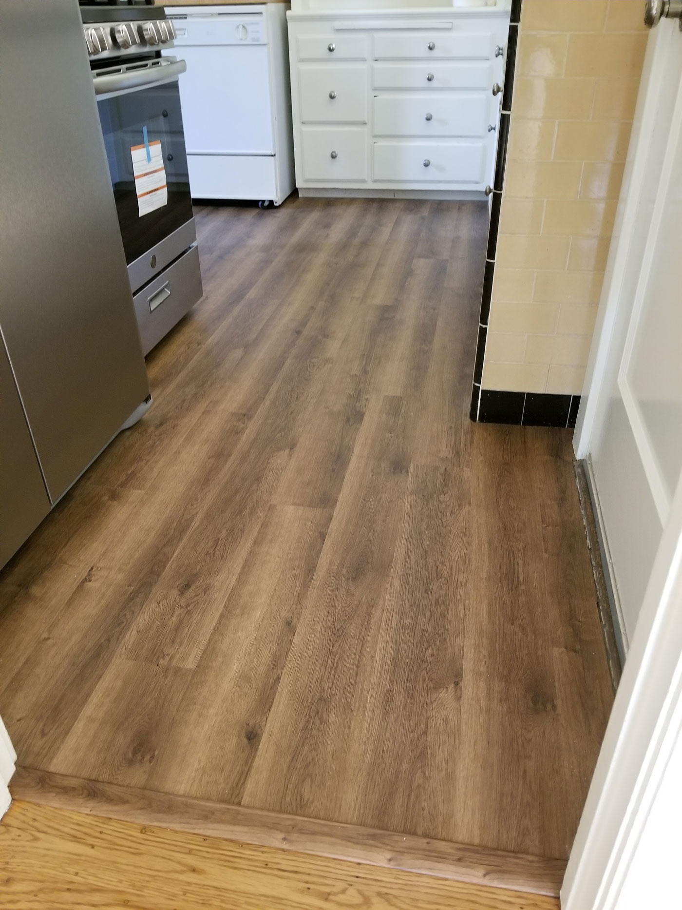 Water-proof LVT (luxury vinyl tile)applied over existing <br/> linoleum floors. 1 25 square-feet — Sunnyvale.
