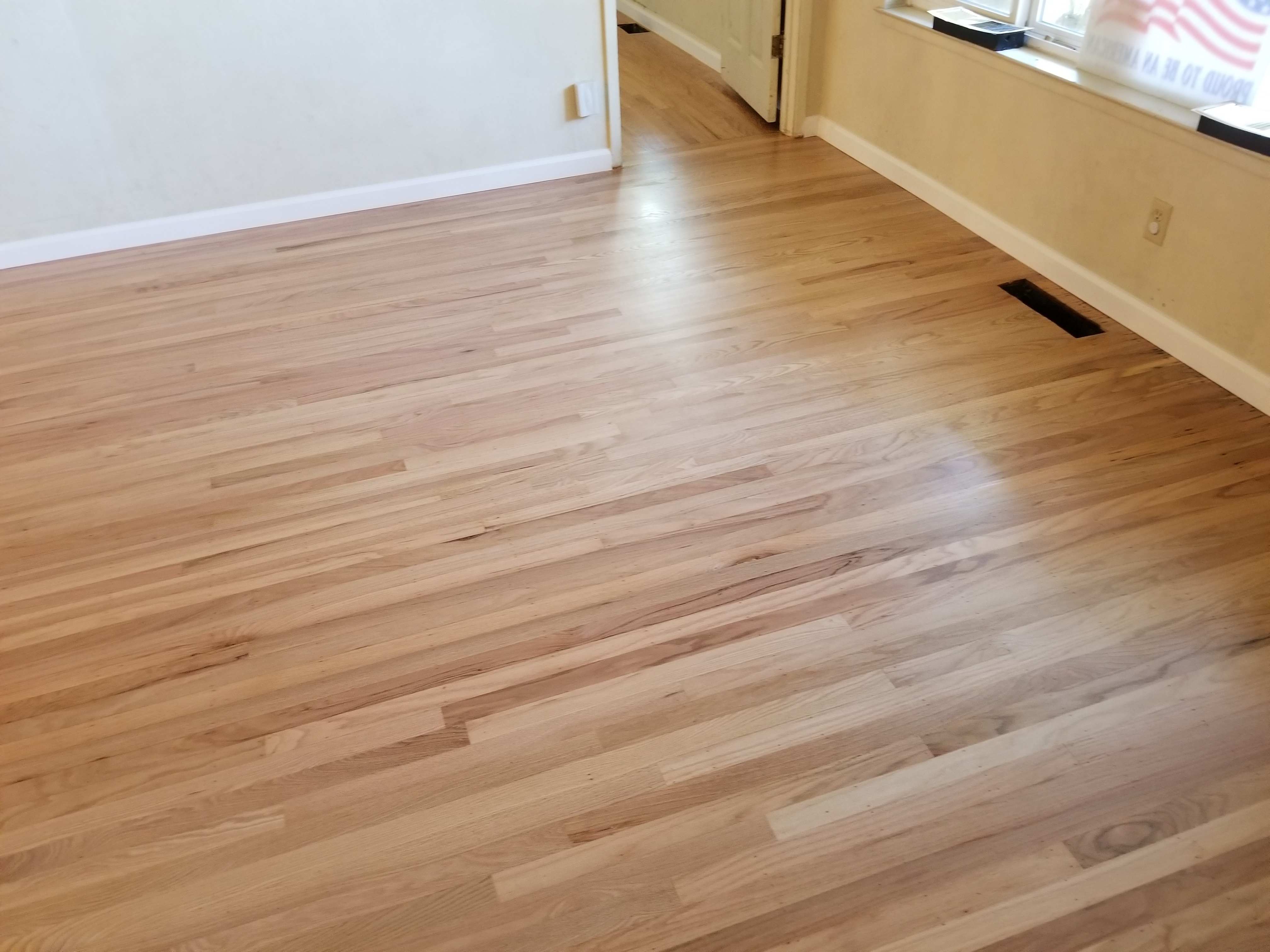 "AFTER - San Jose residential: ""Beautiful"" once again after refinishing 400 square foot living room flooring and repairing the 65 square foot entry way flooring."