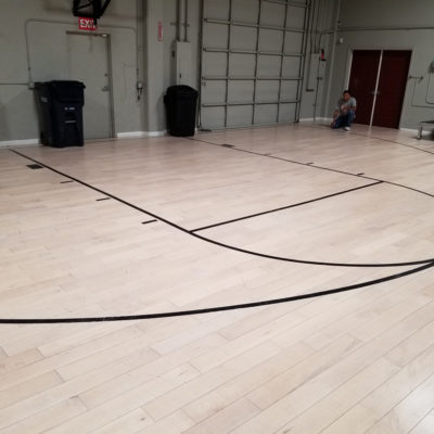 Commercial Repair, Santa Clara: Recoat realtor's in-house basketball court.  Elegant Floors installs, refinishes and repairs basketball courts and gymnasium floors, for schools, fitness clubs and more.