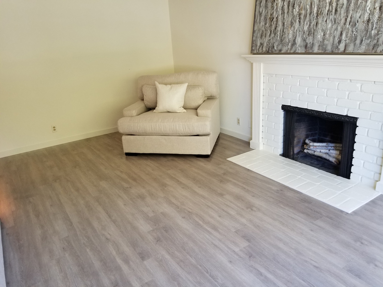 Palo Alto, Flooring Installation: Waterproof, luxury vinyl tile (LVT), 266 square feet. Installed in liviningroom in one day.