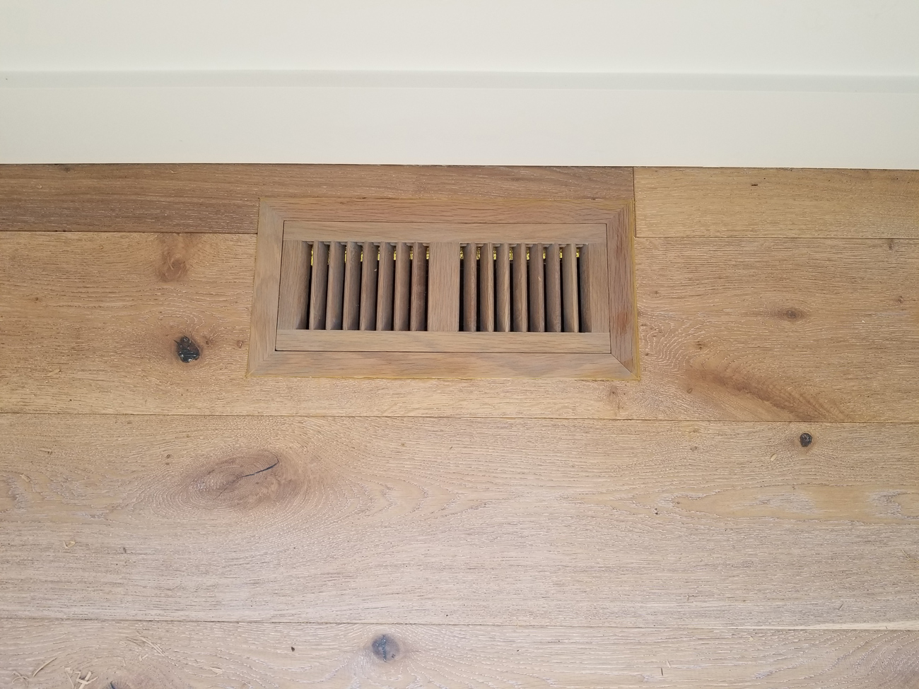 "AFTER: Retrofit vent - flush and mount - to 7"" prefinished stained European white oak flooring, Los Altos."