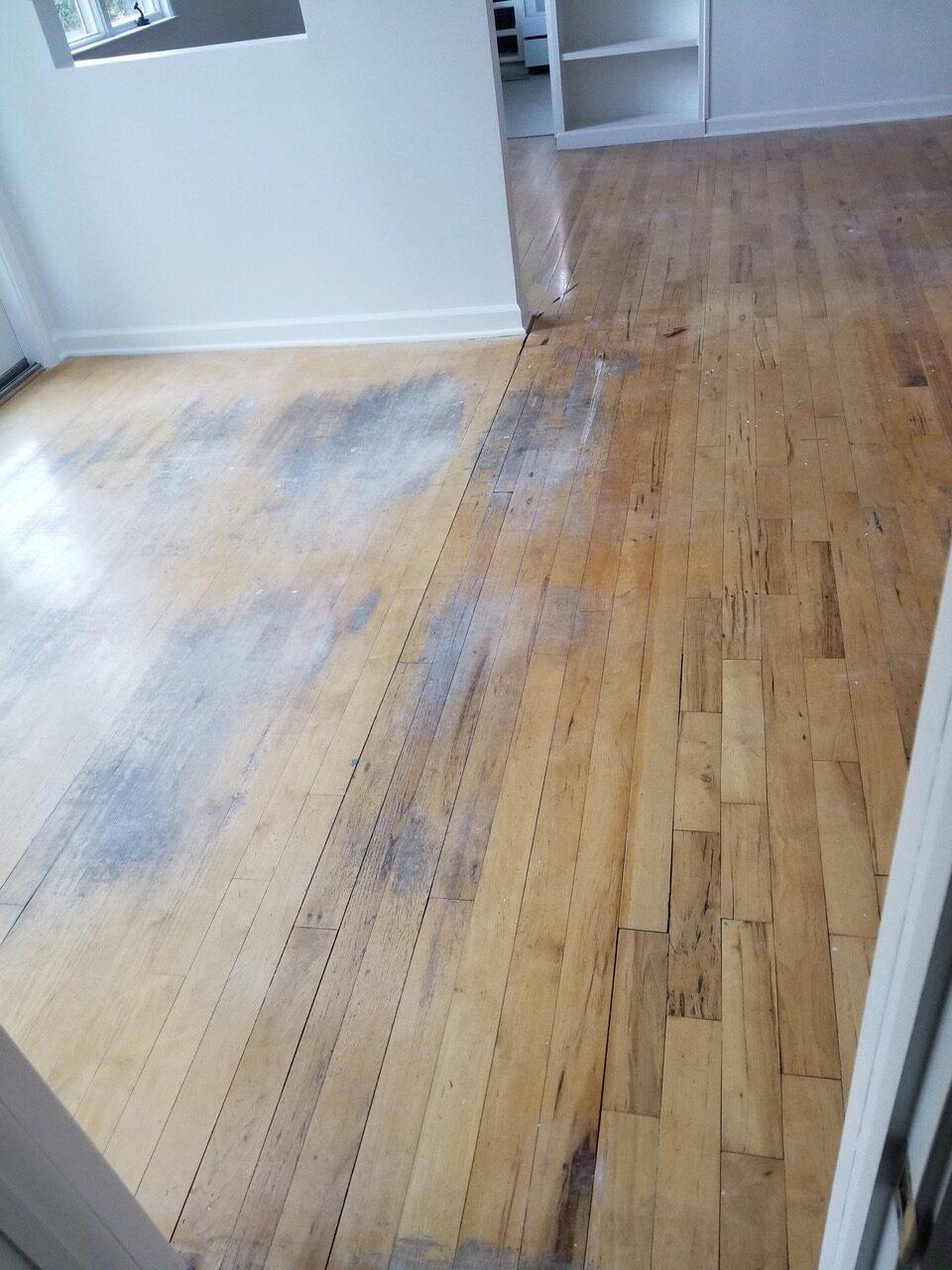 """Before"": San Jose residential hickory nutmeg flooring in need of major repairs."