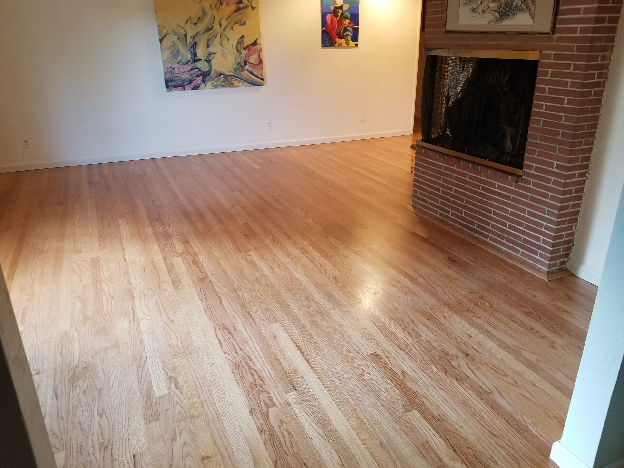 Los Atos family room with newly installed white oak flooring with custom pecan finish, 3 coats.