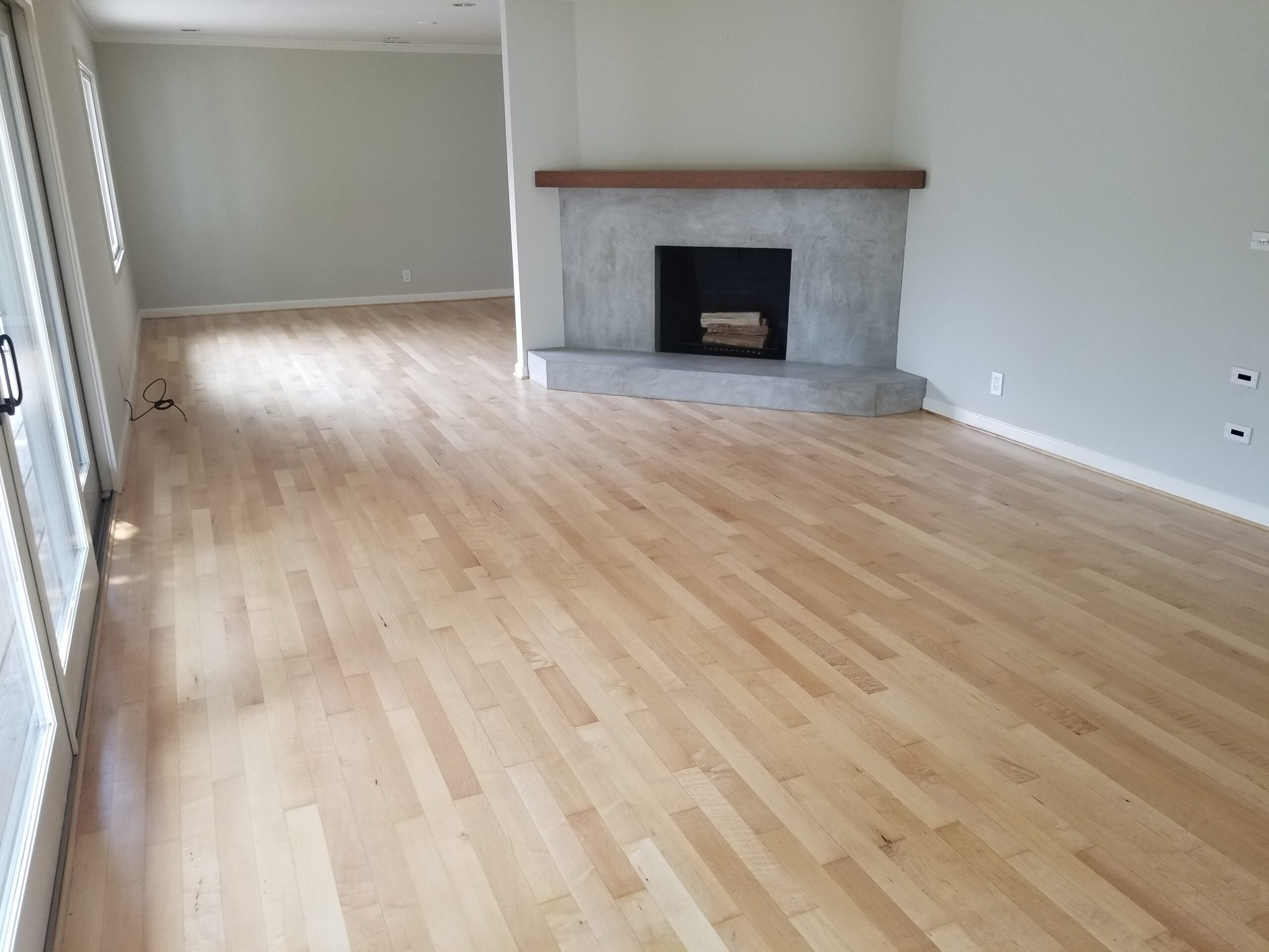 Los Altos home with living room/dining room 3/4 x 3 1/4 Maple floor refinished and coated with amber-water-based semi-gloss finish.