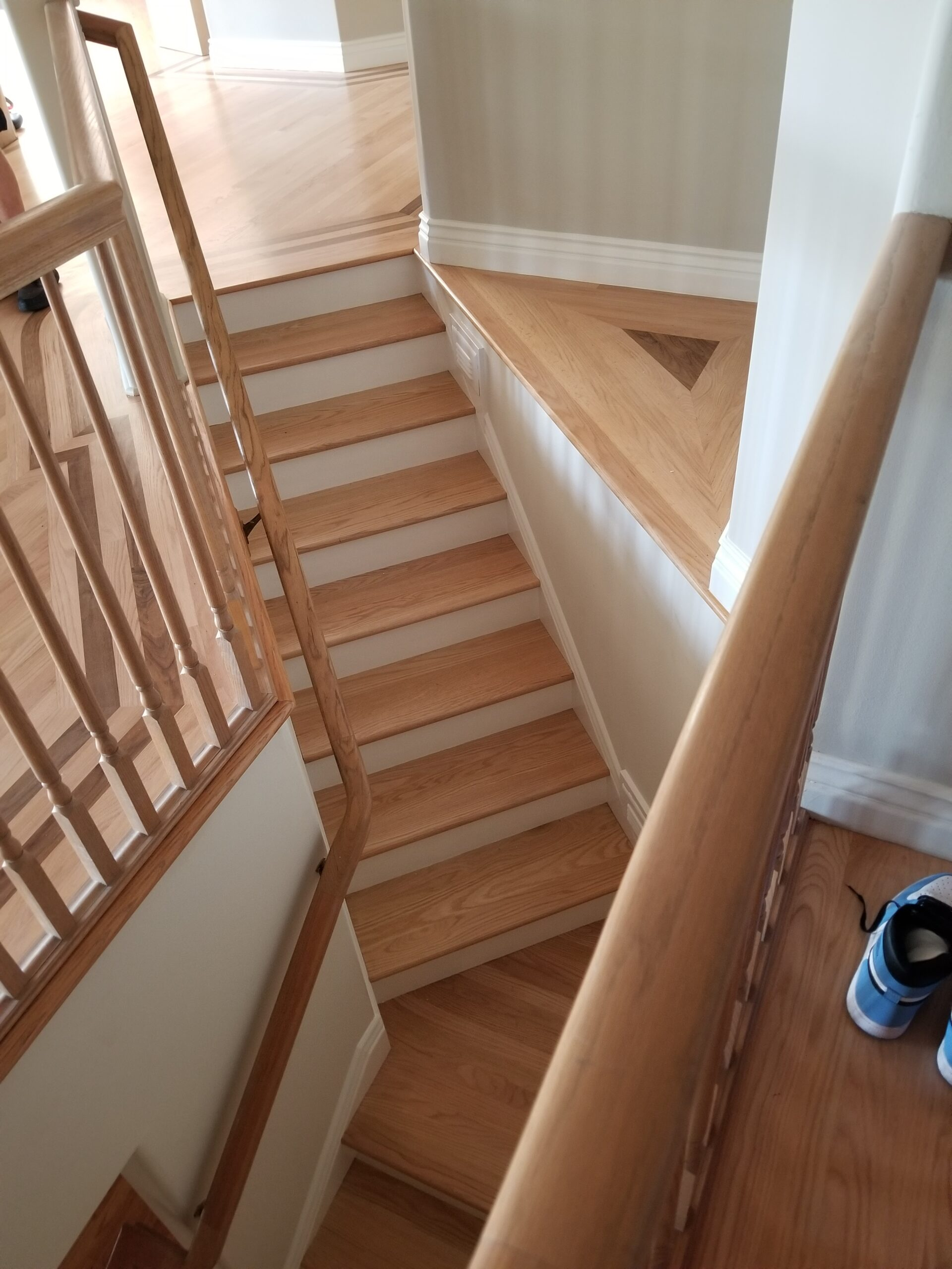 Los Altos Hills residential: red oak stair assembly -- kitchen to downstairs; stain and refinish.