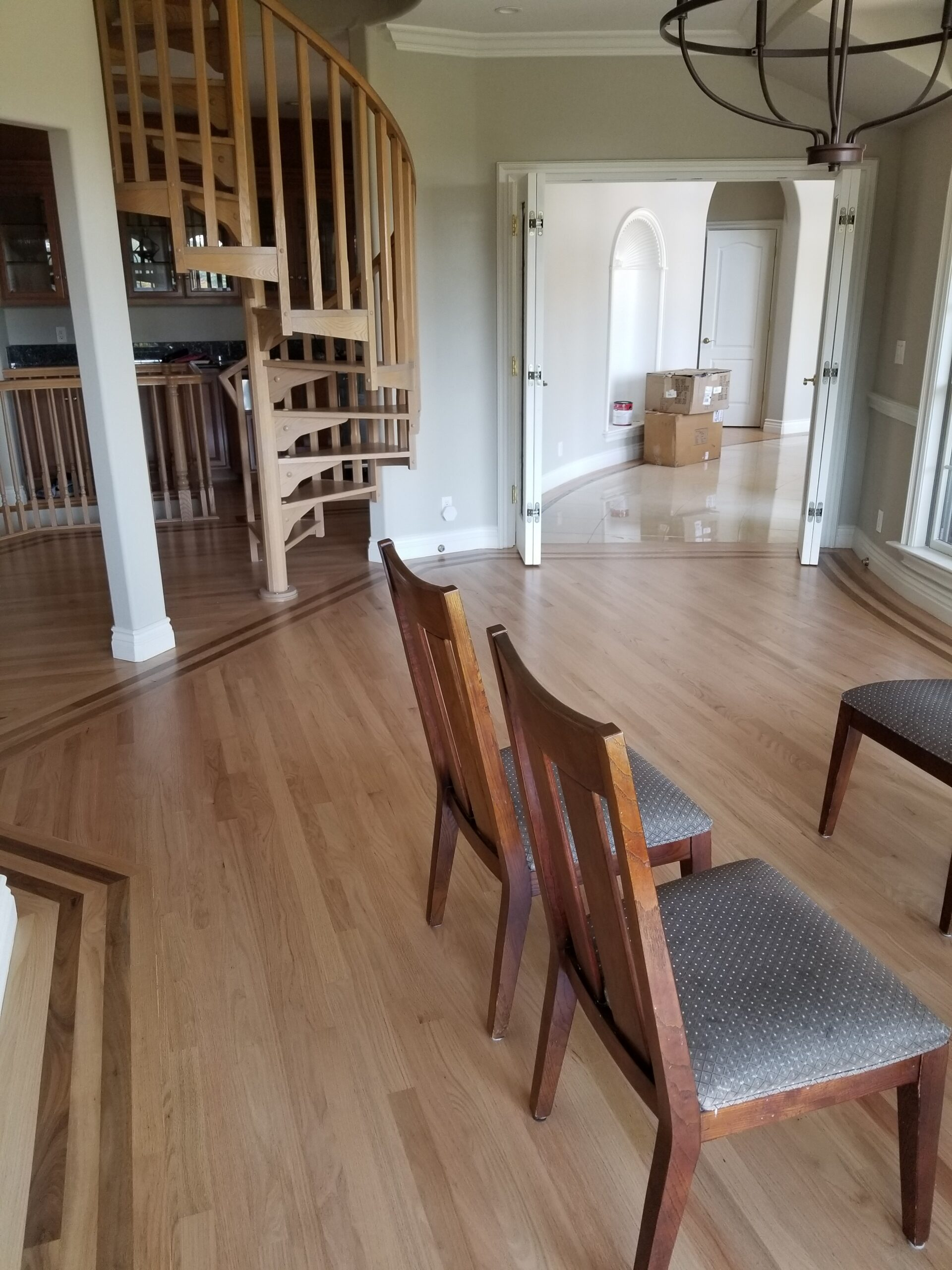 Los Altos Hills residential: dining room after stain and refinish red oak flooring.