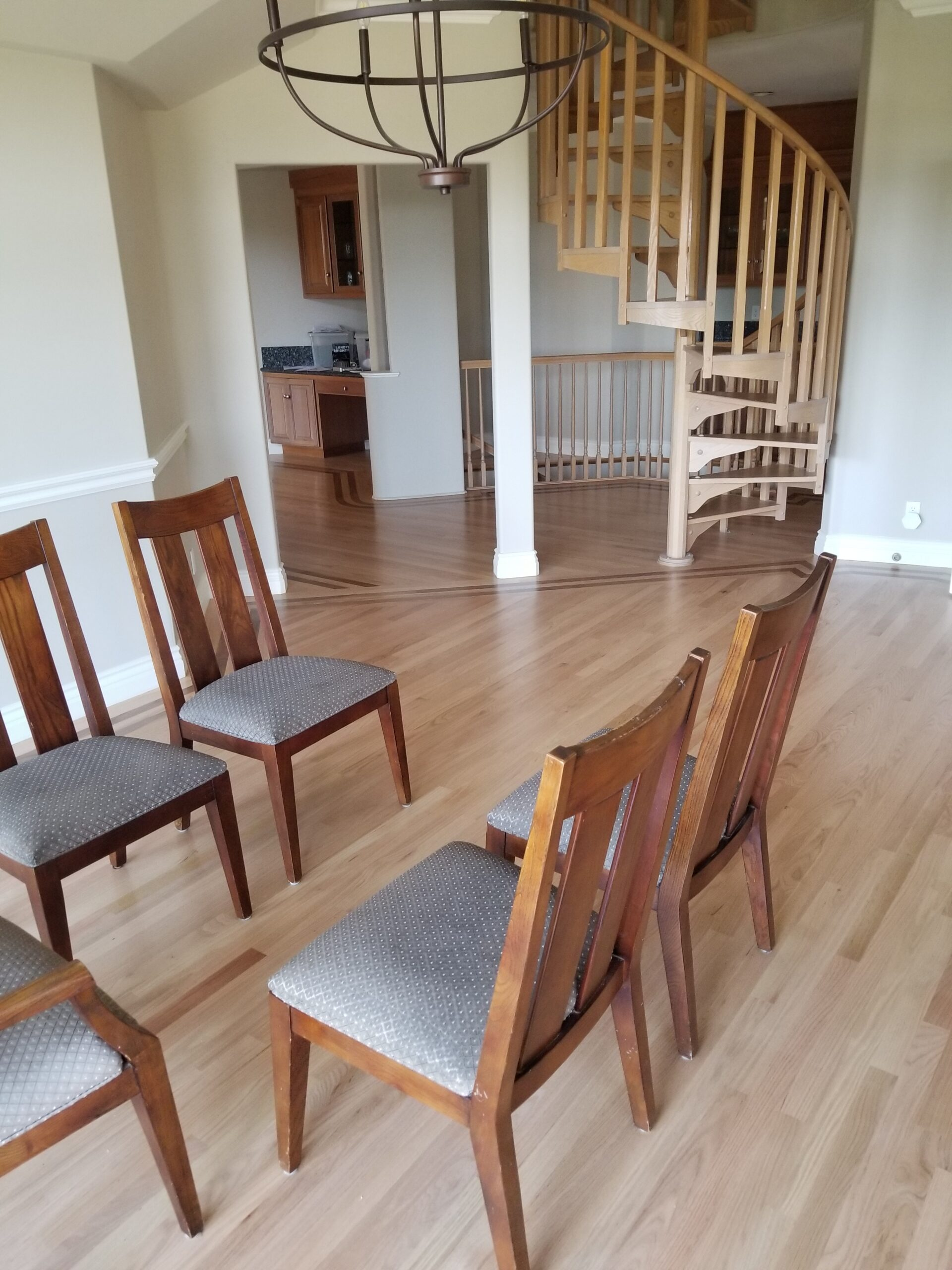 Los Altos Hills residential: same dining room after stain and refinish red oak flooring.