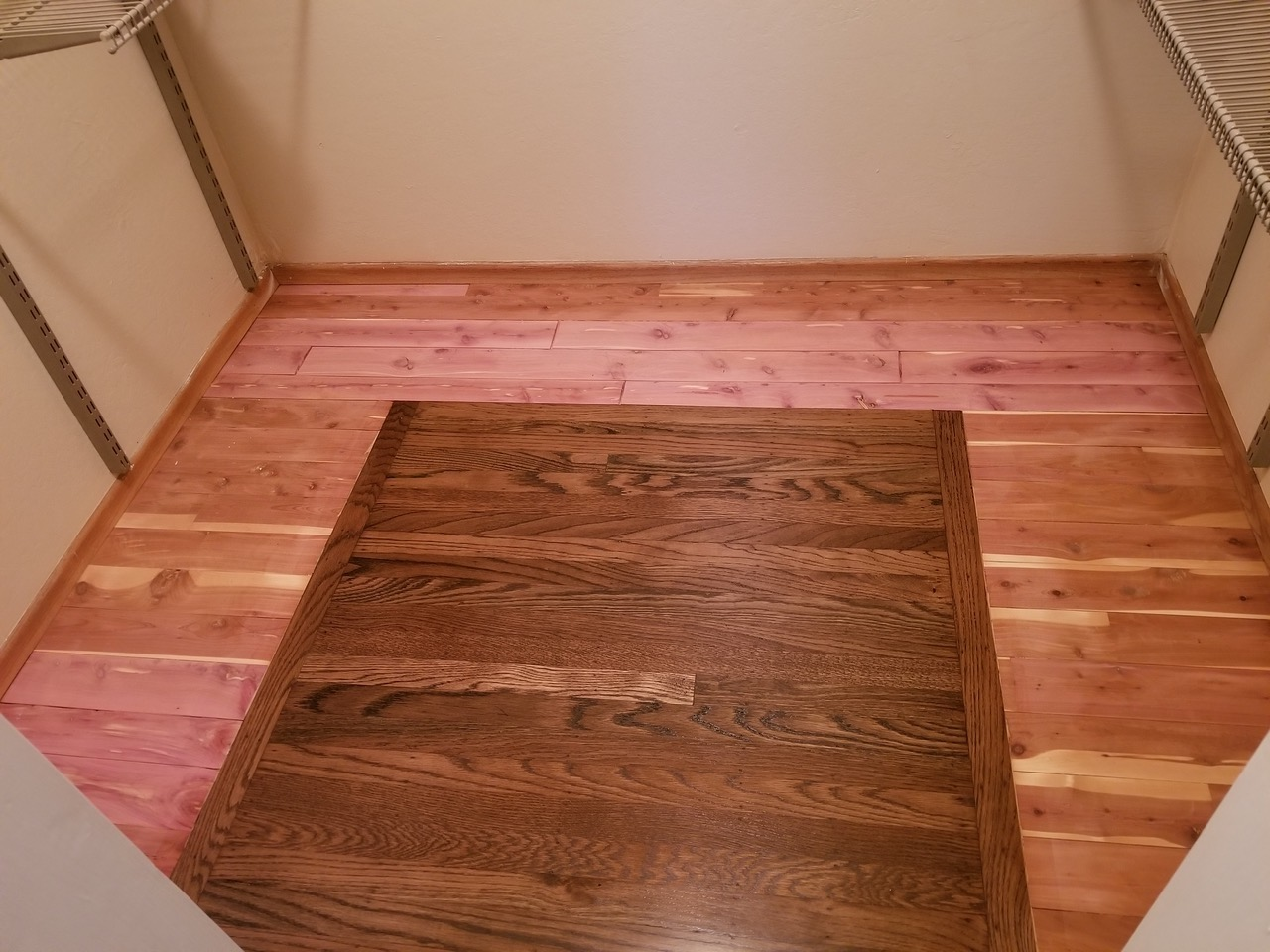 "Saratago ""after"" -  custom red oak floor installation with a cedar border, master bedroom approx 200 square feet."