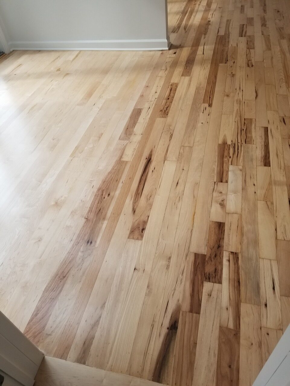"""After"": San Jose residential hickory nutmeg flooring repairs and refinish to bed rooms, hallways and studio. About 1475 square feet."