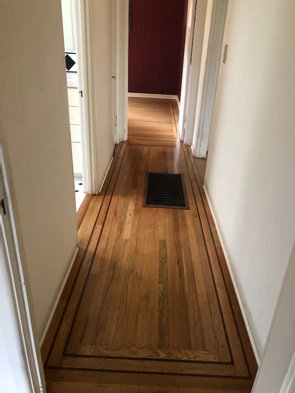 Custom stained hallawy flooring.