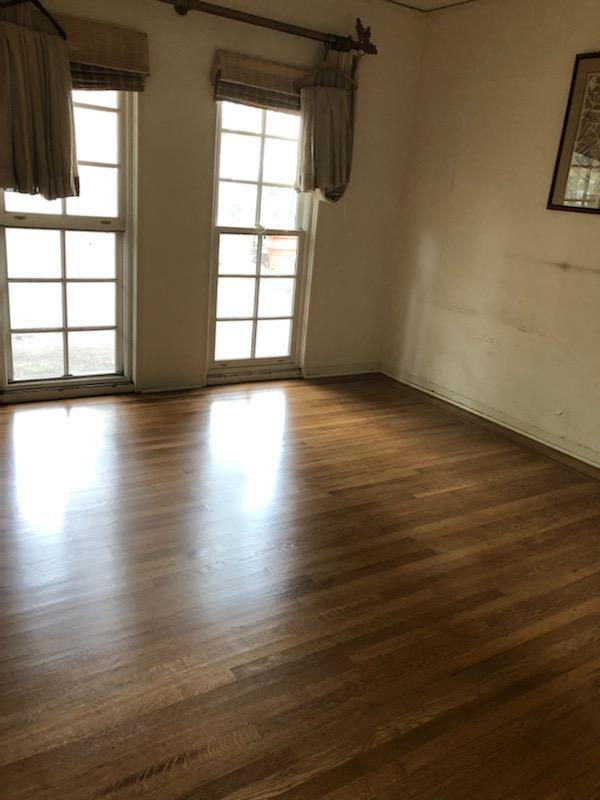 Master bedroom's 100 year-old floors look like new again.