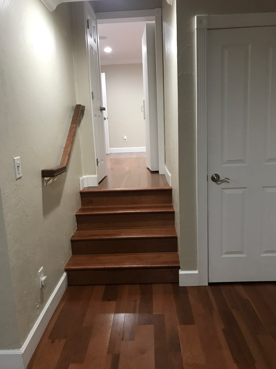 Hickory nutmeg flooring installed in entryway steps, Los Altos residential.