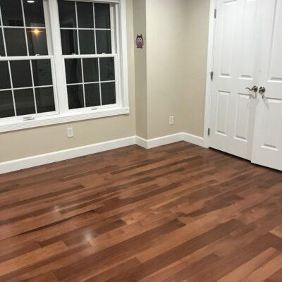 Hickory nutmeg flooring installed in bedroom, Los Altos residential.