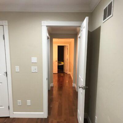 Hickory nutmeg flooring installed in hallway, Los Altos residential.