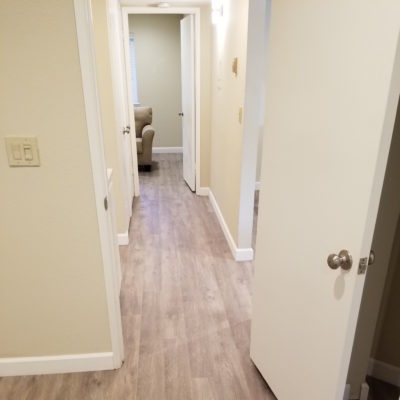 San Jose, Condo: Install 950 square feet LVT waterproof (luxury vinyl tile) flooring throughout living space, including pictuered hallway, living room and office