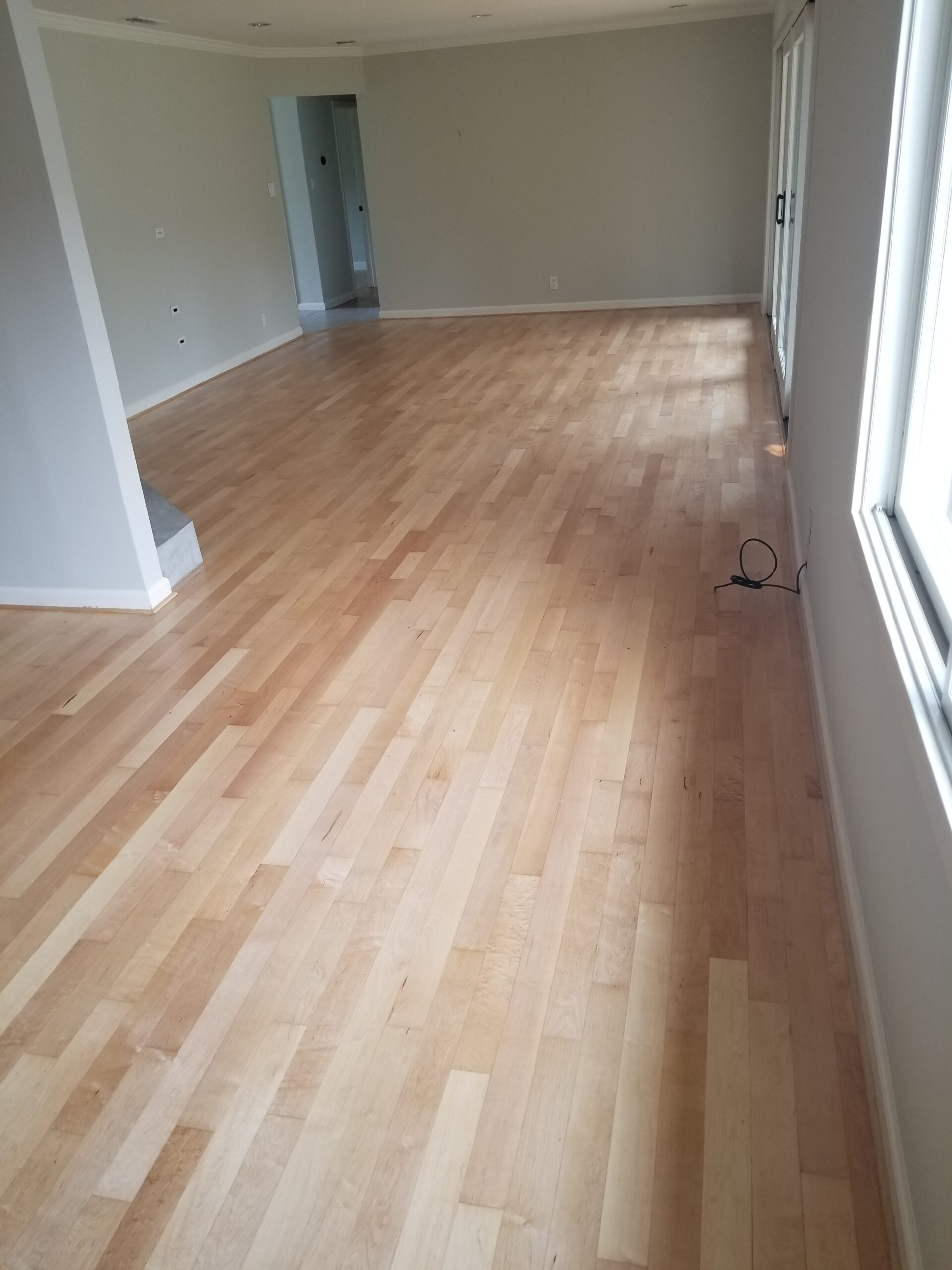 Los Altos residential: refinish amd coat maple wood -- living room to dining room view.