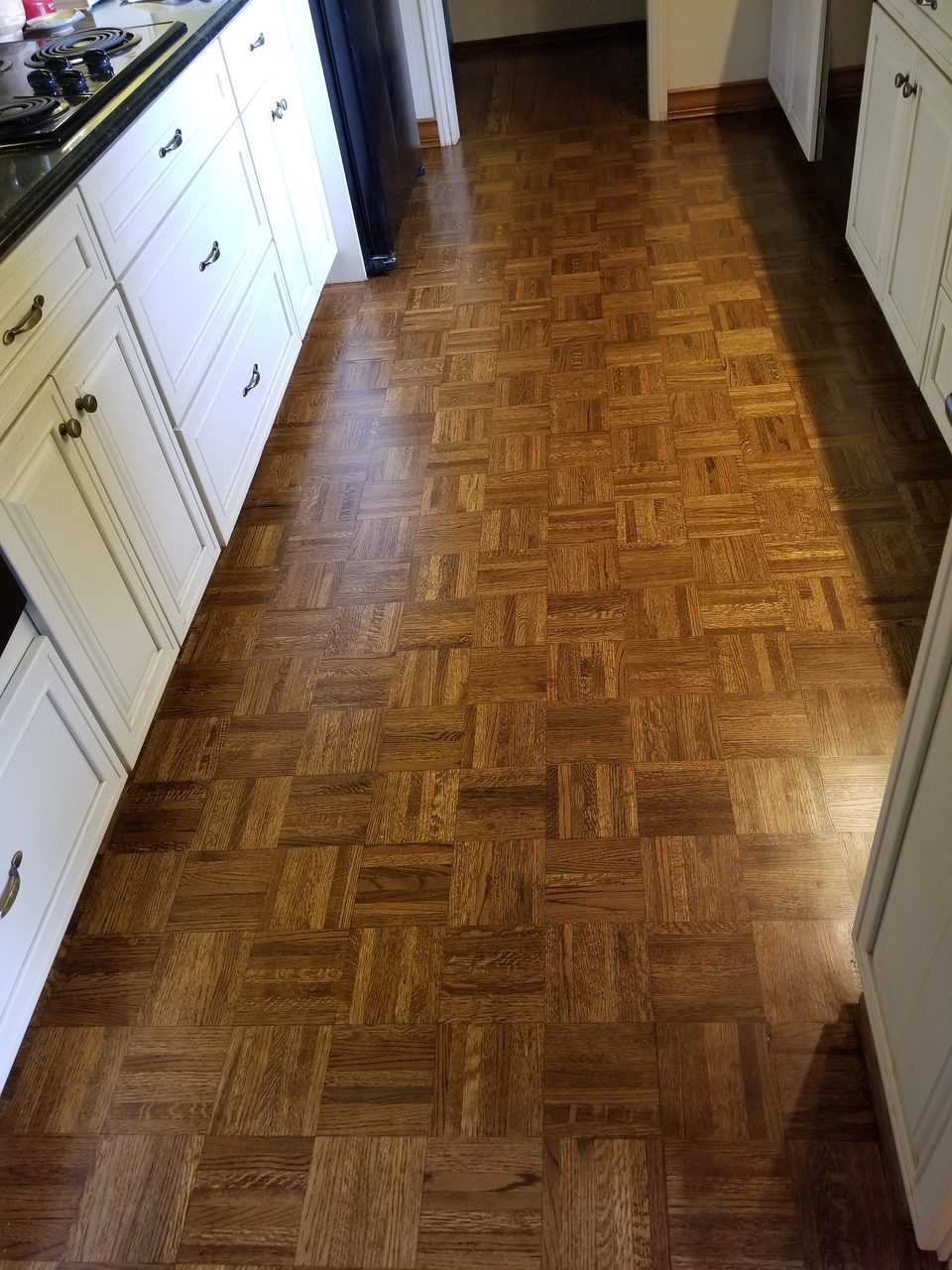 Red Oak Parque Flooring: Sand and refinished with hand-rub stain application and 3-coats of high-grade water-based finish Installed in Los Altos kitchen dinnet, 270 square feet.