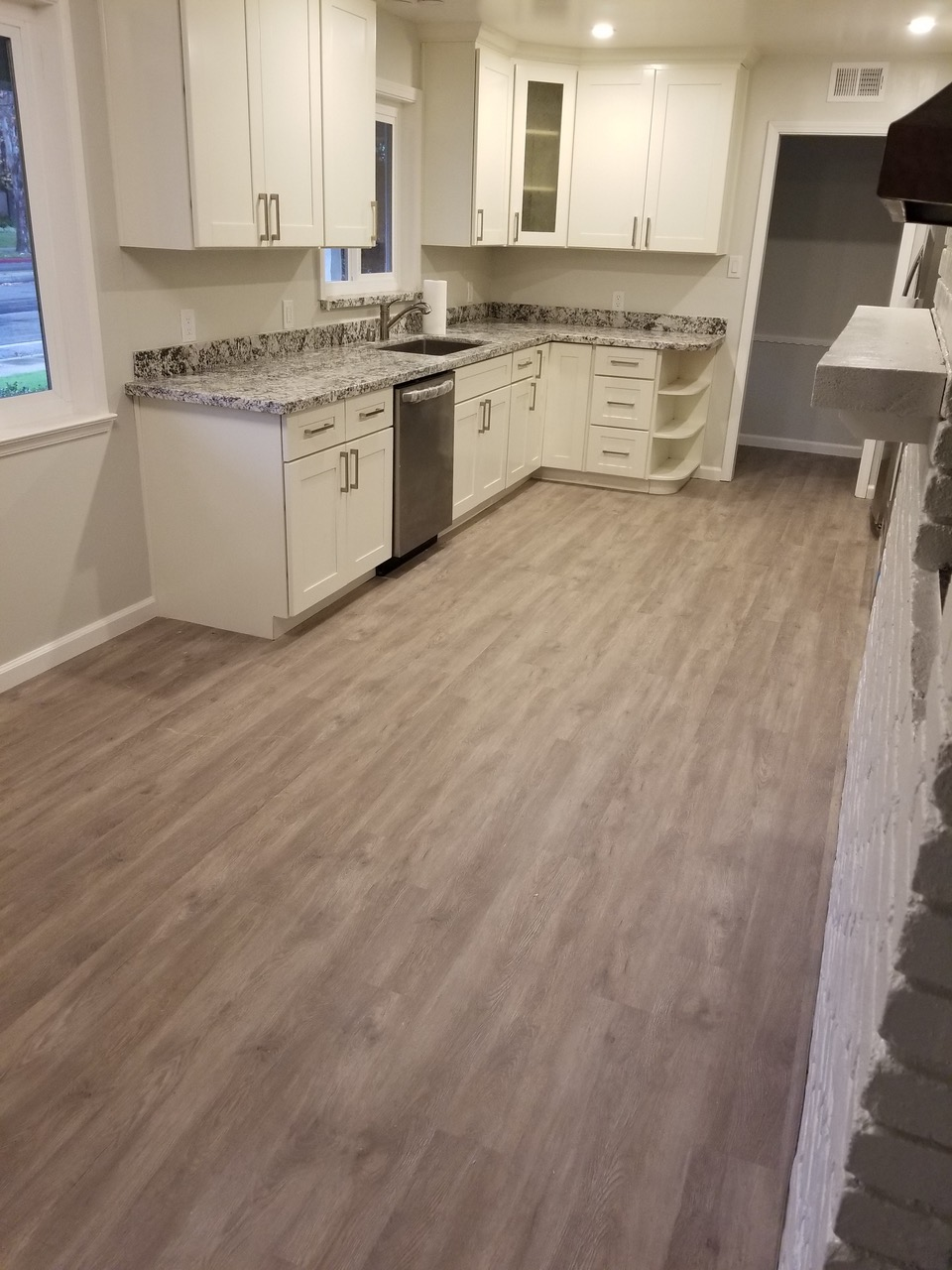 Sales & Wood Flooring Installation: Waterproof luxury vinyl tile                                                                       (LVT) installed  in Mountain View  kitchen dinette, 285 square feet.