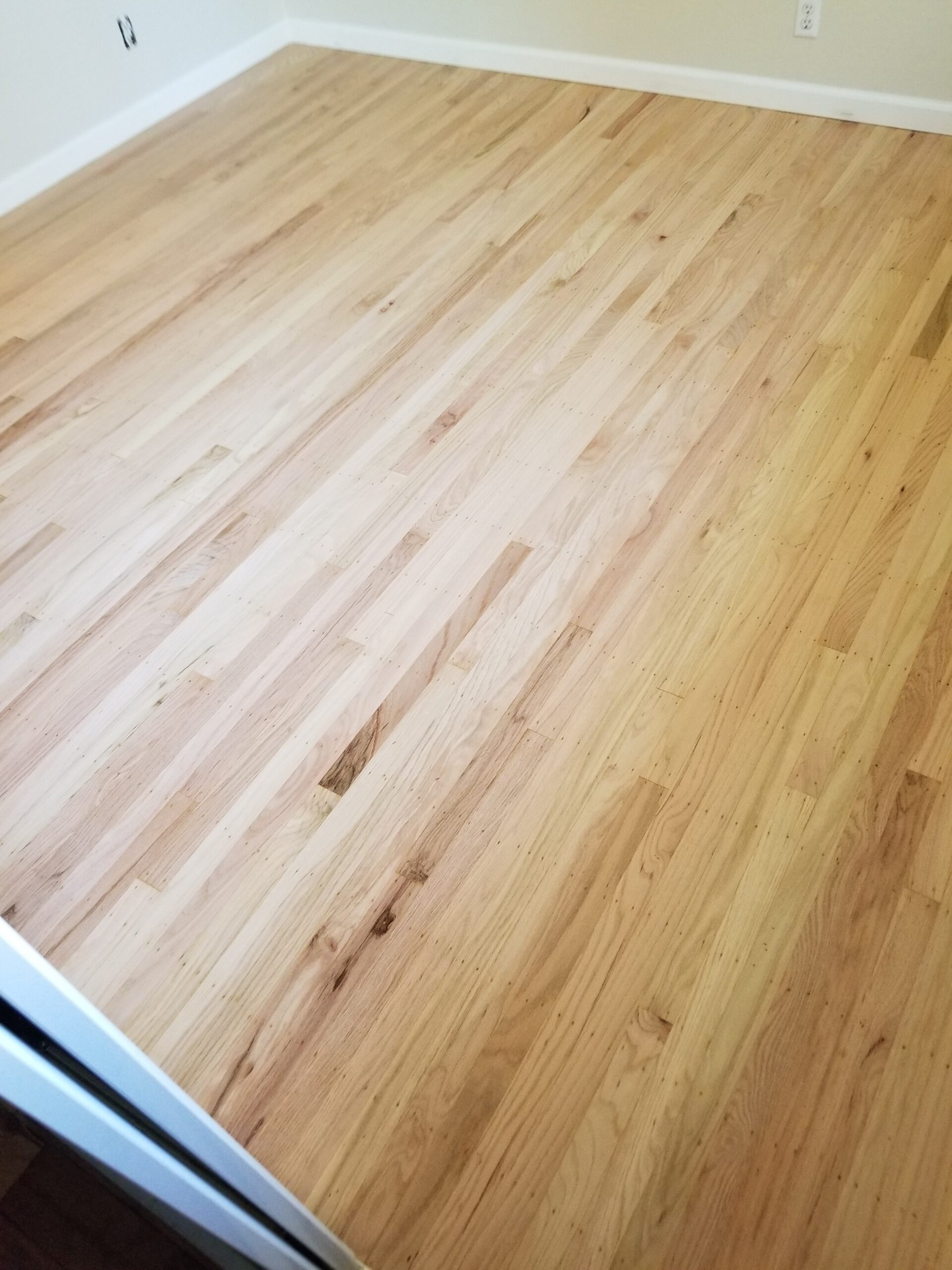 Sunnyvale residential: Three bedroom, hallway refinish red oak 2 inch x 5/16 inch with water-base clear-coat semi-gloss finish.