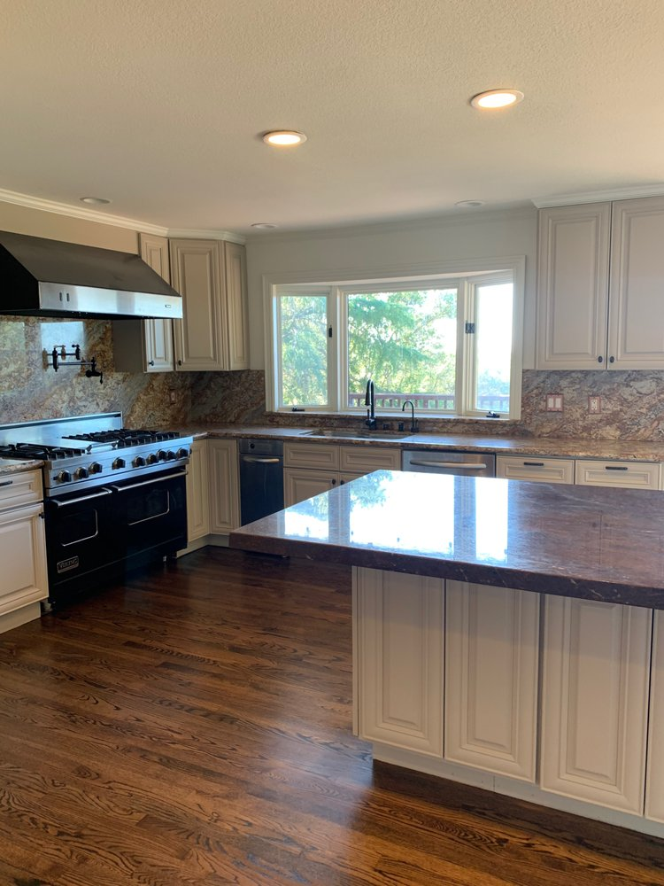 Mt. View - kitchen, 250 square feet, sand and refinish  with medium-brown stain and 3 coats semi-water-base finish.