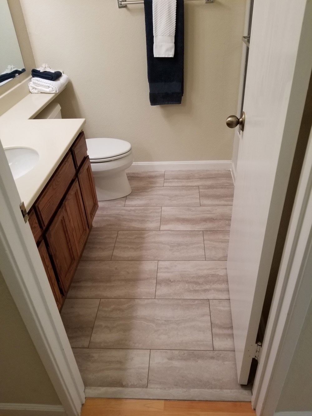 Los Altos,  residential: Waterproof, luxury vinyl tile  (LVT) 28 square feet. Installed in bathroom in one day.